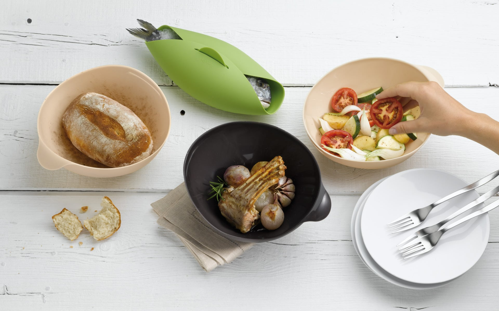 Table set with four silicone cooking bowls.